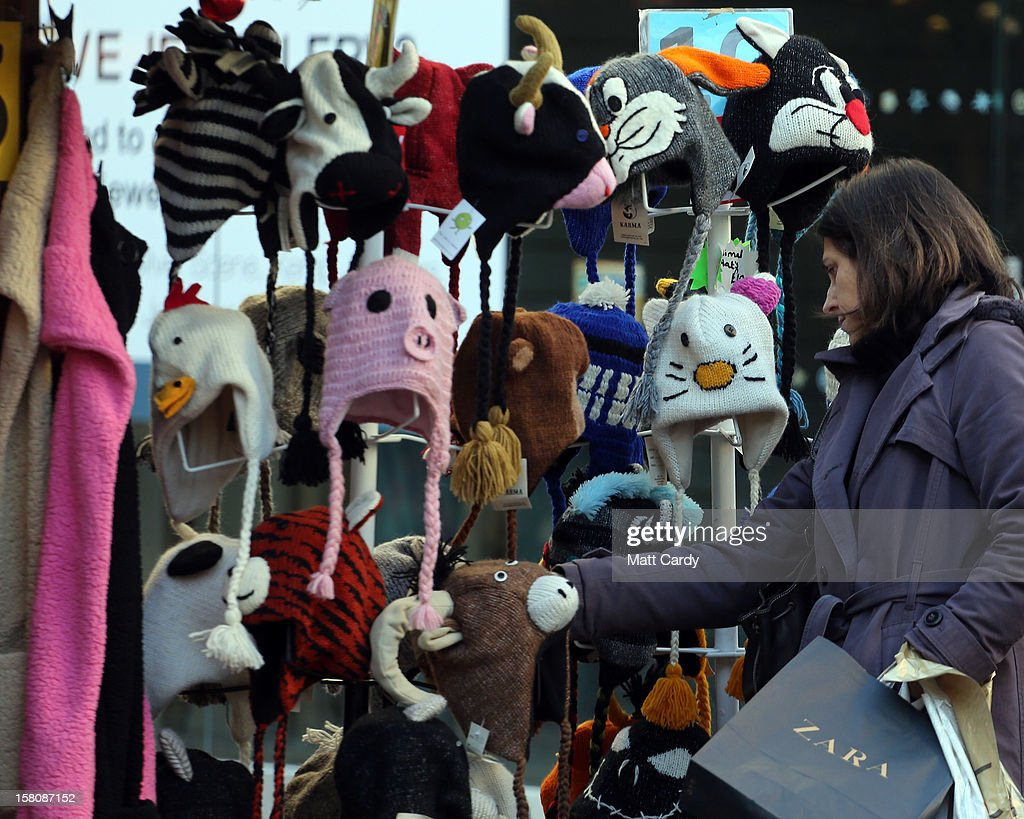 A shopper looks at wooly hats for sale at a stall in a Christmas market on December 10, 2012 in Bristol, England. With internet shopping still on the rise, many traditional retailers claim this Christmas could be the one that will determine the future of the high street.