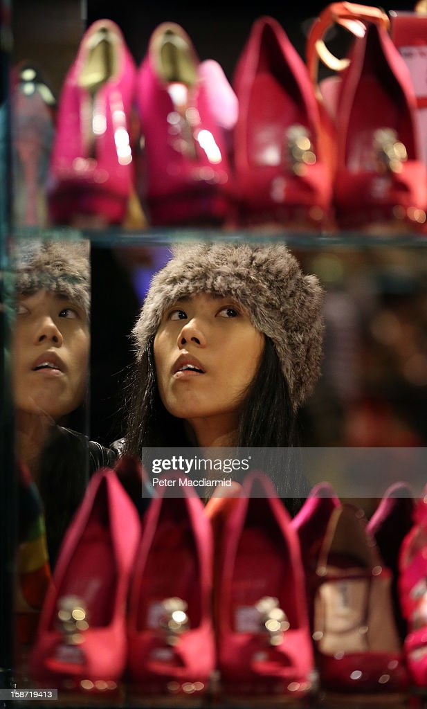 A shopper looks for discounted shoes at Selfridges department store on December 26, 2012 in London, England. Thousands of shoppers are in London looking for a bargain in the traditional Boxing Day sales.