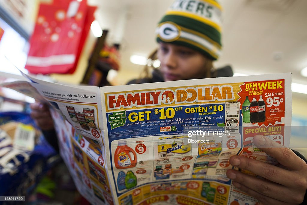 Shopper Mandy Prevello, of East Orange, New Jersey, reads a Family Dollar Stores Inc. advertisement at a store in Belleville, New Jersey, U.S., on Thursday, Jan. 3, 2013. Family Dollar Stores Inc., the second-largest U.S. dollar store chain, tumbled the most in more than 12 years after cutting its fiscal 2013 earnings forecast, saying consumers are reluctant to spend on more-profitable discretionary items. Photographer: Michael Nagle/Bloomberg via Getty Images