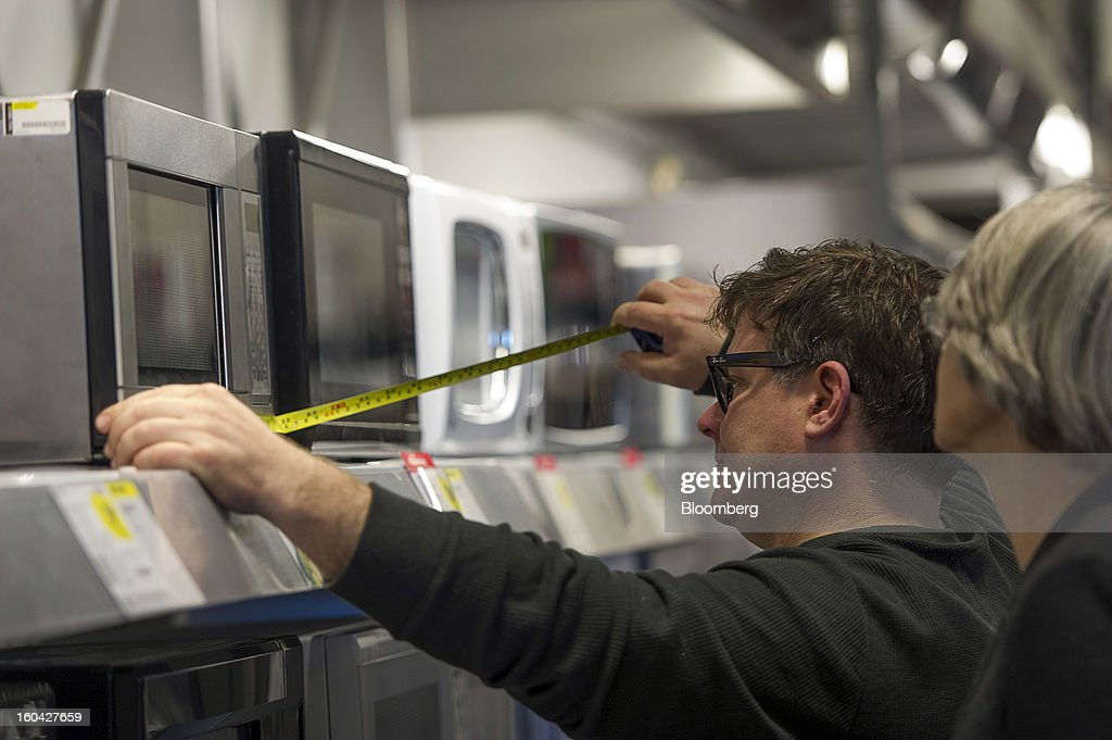 A shopper measures a microwave at a Best Buy Co. store in San Francisco, California, U.S. on Wednesday, Jan. 30, 2013. Consumer spending in the U.S. climbed in December as incomes grew by the most in eight years, a sign the biggest part of the economy was contributing to the expansion as the year drew to a close. Photographer: David Paul Morris/Bloomberg via Getty Images