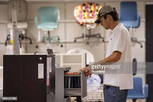 A shopper opens a filing cabinet drawer displayed for sale inside an IKEA AB store in Emeryville California US on Tuesday Aug 9 2016 The US Census...