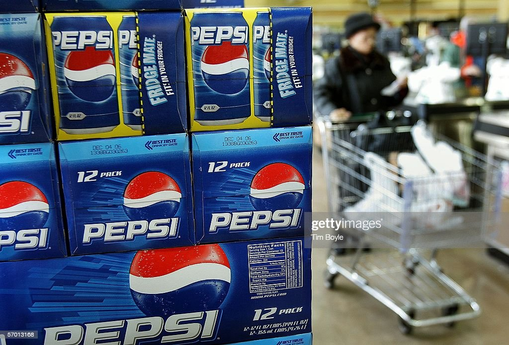 A shopper passes a display of 12-packs of Pepsi at a market March 6, 2006 in Des Plaines, Illinois. A new study reportedly links sugary sodas and drinks to the obesity epidemic.