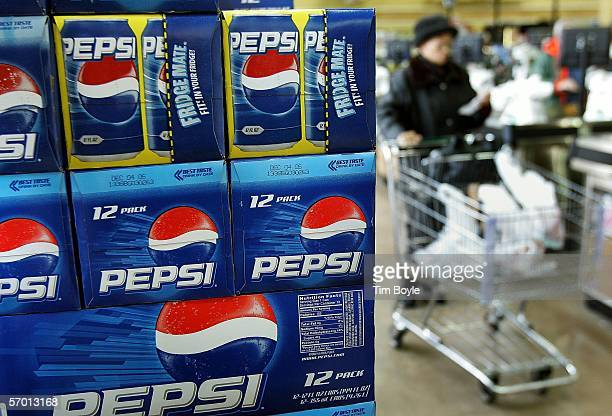 A shopper passes a display of 12packs of Pepsi at a market March 6 2006 in Des Plaines Illinois A new study reportedly links sugary sodas and drinks...