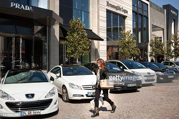 A shopper passes a Prada SpA store at the Istinye Park shopping mall in Istanbul Turkey on Saturday March 17 2012 Turkey's central bank is urging...