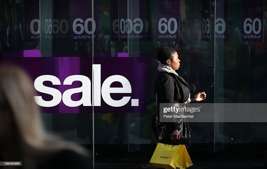 A shopper passes a sale sign in Oxford Street on December 17, 2012 in London, England. Thousands of shoppers are expected in London's west end in the hunt for Christmas bargains in the next week.