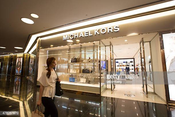 A shopper passes the entrance to a Michael Kors Holdings Ltd fashion store at the Esentai luxury shopping mall in Almaty Kazakhstan on Tuesday June...