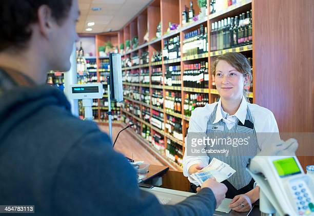 A shopper paying at the supermarket checkout pictured on July 04 2013 in Bonn Germany