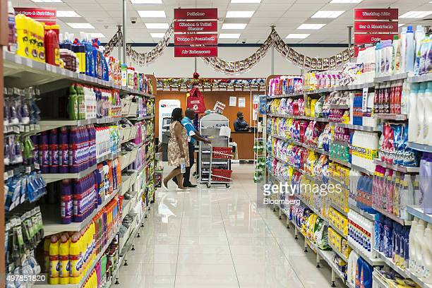 A shopper pushes a basket trolley past the cleaning products aisle inside a Choppies supermarket operated by Choppies Enterprises Ltd in Rustenburg...