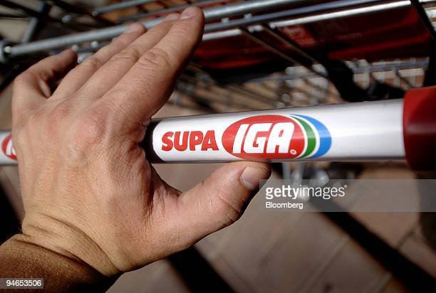 A shopper pushes a cart at an IGA supermarket in Sydney Australia on Tuesday Dec 4 2007 Metcash Ltd said firsthalf profit rose 30 percent after...