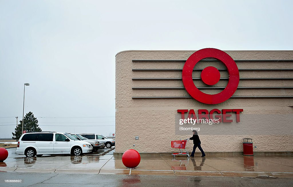 A shopper pushes a cart outside a Target Corp. store in Peru, Illinois, U.S., on Thursday, Feb. 7, 2013. Target Corp. led U.S. retailers to the biggest monthly same-store sales gain in more than a year as shoppers snapped up discounted merchandise chains were clearing out after the holidays. Photographer: Daniel Acker/Bloomberg via Getty Images