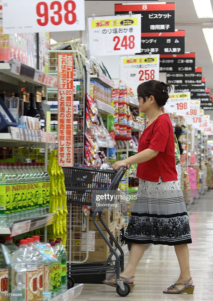 A shopper pushes a shopping cart at a Daiei Inc. supermarket during a sale jointly held with Aeon Co. at a Daiei supermarket in Urayasu City, Chiba Prefecture, Japan, on Thursday, Aug. 22, 2013. Aeon's acquisition of 48.4 million Daiei shares will take place on Aug. 27 after the completion of tender offer yesterday, according to a statement to the Tokyo Stock Exchange released today. Photographer: Tomohiro Ohsumi/Bloomberg via Getty Images