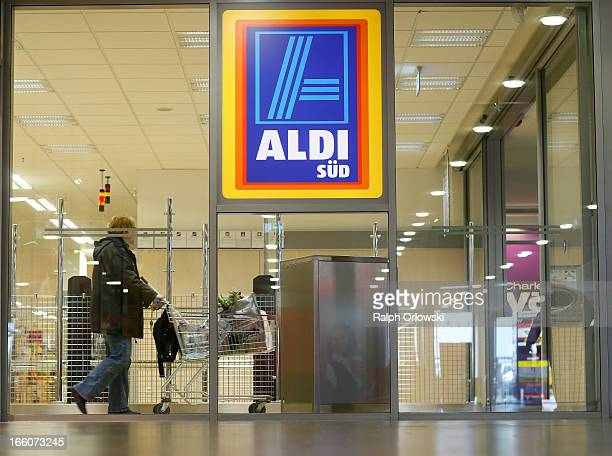A shopper pushes a shopping cart in an Aldi store on April 8 2013 in Ruesselsheim near Frankfurt Germany Aldi which today is among the world's most...