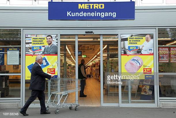 A shopper pushes a shopping cart into a Metro AG Cash Carry store in Frankfurt Germany on Wednesday July 28 2010 Metro reports its earning later this...