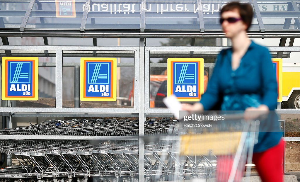 A shopper pushes a shopping cart near an Aldi store on April 8, 2013 in Ruesselsheim near Frankfurt, Germany. Aldi, which today is among the world's most successful discount grocery store chains, will soon mark its 100th anniversary and traces its history back to Karl Albrecht, who began selling baked goods in Essen on April 10, 1913 and founded the Aldi name by shortening the phrase Albrecht Discount. His sons Karl Jr. and Theo expanded the chain dramatically, creating 300 stores by 1960 divided between northern and southern Germany, with Aldi Nord and Aldi Sued, respectively. Today the two chains have approximately 4,300 stores nationwide and have also expanded into other countries across Europe and the USA. Aldi Nord operates in the USA under the name Trader Joe's.