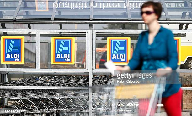 A shopper pushes a shopping cart near an Aldi store on April 8 2013 in Ruesselsheim near Frankfurt Germany Aldi which today is among the world's most...