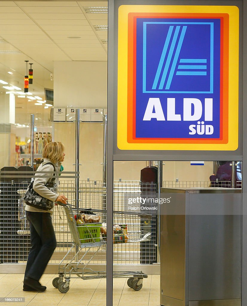 A shopper pushes a trolley in an Aldi store on April 8, 2013 in Ruesselsheim near Frankfurt, Germany. Aldi, which today is among the world's most successful discount grocery store chains, will soon mark its 100th anniversary and traces its history back to Karl Albrecht, who began selling baked goods in Essen on April 10, 1913 and founded the Aldi name by shortening the phrase Albrecht Discount. His sons Karl Jr. and Theo expanded the chain dramatically, creating 300 stores by 1960 divided between northern and southern Germany, with Aldi Nord and Aldi Sued, respectively. Today the two chains have approximately 4,300 stores nationwide and have also expanded into other countries across Europe and the USA. Aldi Nord operates in the USA under the name Trader Joe's.