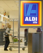 A shopper pushes a trolley in an Aldi store on April 8 2013 in Ruesselsheim near Frankfurt Germany Aldi which today is among the world's most...