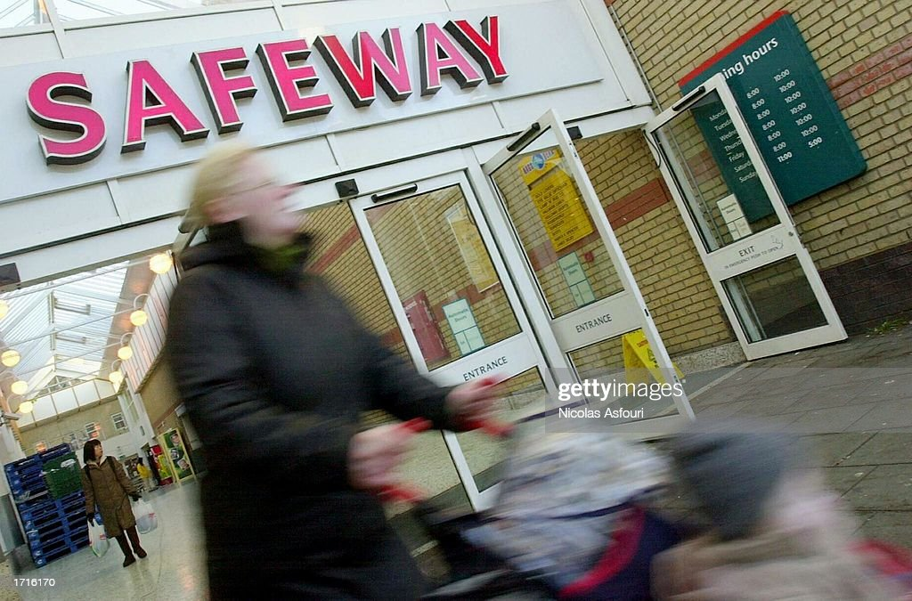 A shopper pushes a trolley outside a Safeway supermarket in central London, England on January 9, 2003. Safeway has announced that rival retailers Morrisons have secured a ?2.9 billion take over bid for the nationwide chain of Supermarkets. The deal is expected to lead to 1,200 job cuts among 'non-store personnel'.
