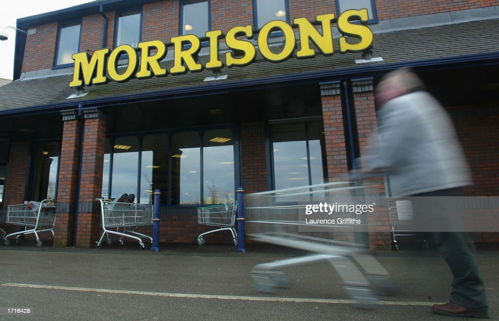 A shopper pushes his cart outside a Morrisons supermarket January 9, 2003 in Rochdale, Lancashire. The mid-size British supermarket chain, Morrisons, announced its bid to overtake rival Safeway in a 2.9 billion pound deal that would combine the firm with 589 stores and a 16 percent market share.