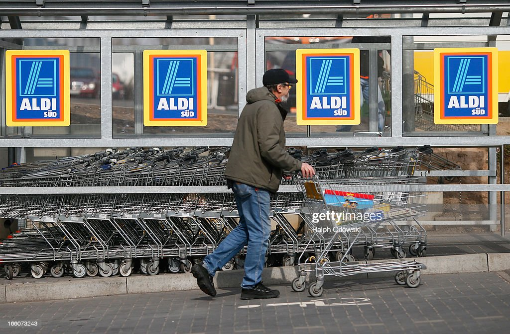 A shopper pushs a shopping cart outside an Aldi store on April 8, 2013 in Ruesselsheim near Frankfurt, Germany. Aldi, which today is among the world's most successful discount grocery store chains, will soon mark its 100th anniversary and traces its history back to Karl Albrecht, who began selling baked goods in Essen on April 10, 1913 and founded the Aldi name by shortening the phrase Albrecht Discount. His sons Karl Jr. and Theo expanded the chain dramatically, creating 300 stores by 1960 divided between northern and southern Germany, with Aldi Nord and Aldi Sued, respectively. Today the two chains have approximately 4,300 stores nationwide and have also expanded into other countries across Europe and the USA. Aldi Nord operates in the USA under the name Trader Joe's.