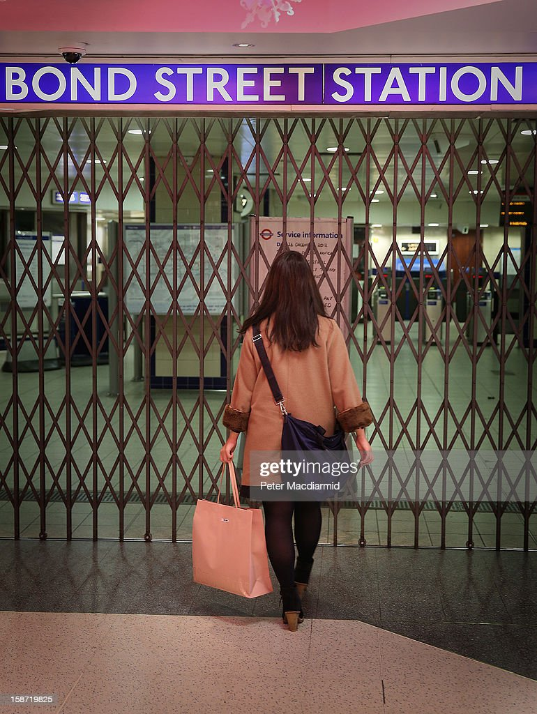 A shopper reads a sign explaining that Bond Street underground station is closed due to industrial action on December 26, 2012 in London, England. Thousands of shoppers are in London looking for a bargain in the traditional Boxing Day sales. Shoppers also faced disruptions due to striking London Underground drivers.