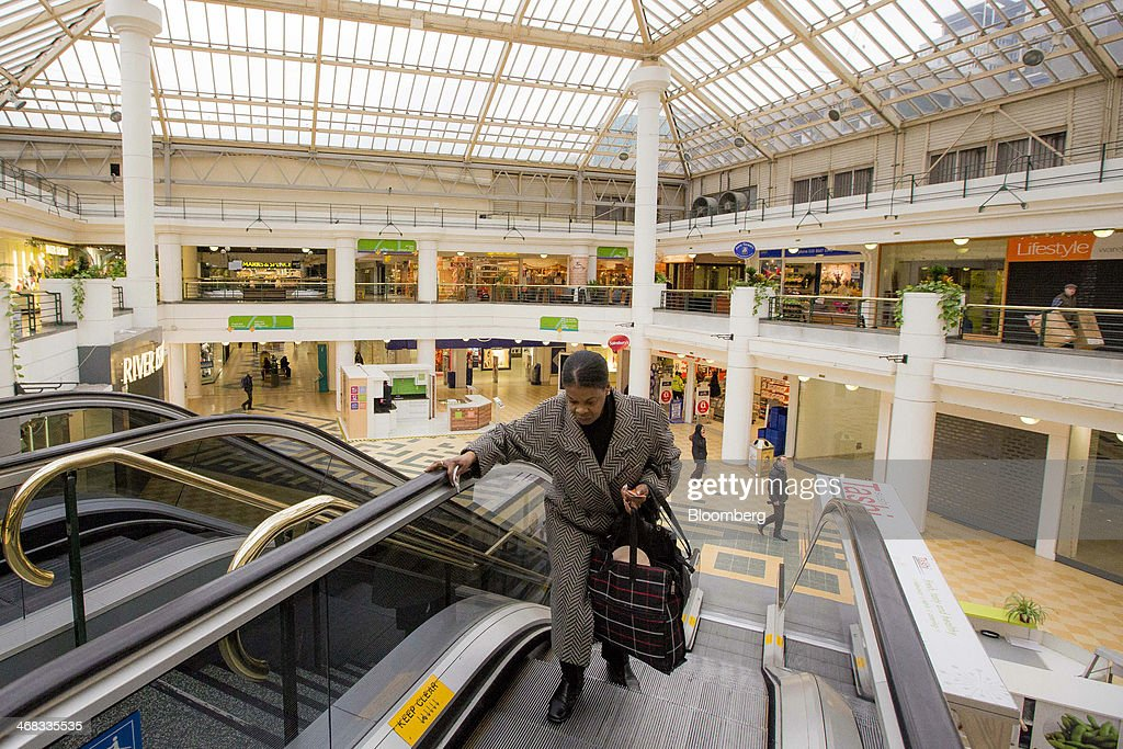 A shopper rides on an escalator between floors inside the Whitgift Centre shopping mall in Croydon, south London, U.K., on Monday, Feb. 10, 2014. Westfield Group, Australia's biggest mall operator, and Hammerson Plc won preliminary approval to rebuild the Whitgift Centre mall in south London as part of a project valued at about 1 billion pounds ($1.6 billion). Photographer: Jason Alden/Bloomberg via Getty Images