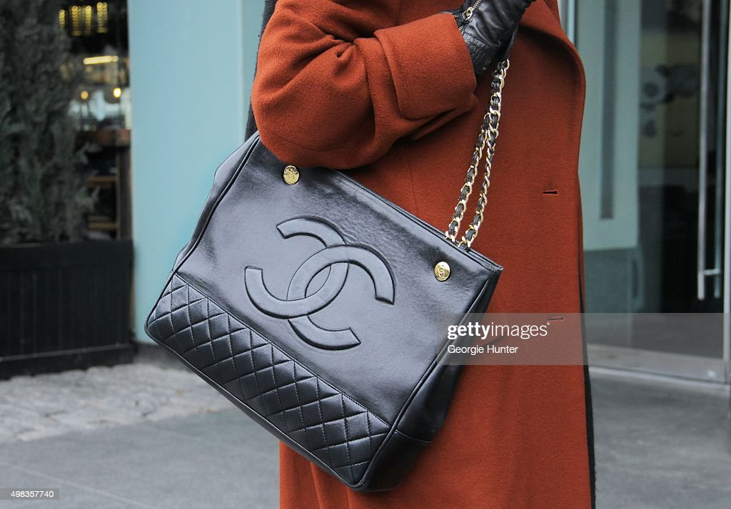 Shopper seen on the streets of Manhattan wearing black leather Chanel bag with gold chain strap on November 22 2015 in New York City