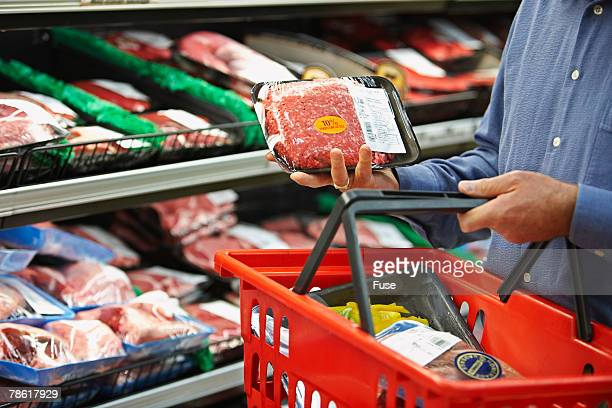 Shopper Selecting Package of Ground Beef