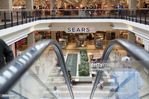 A shopper sit in front of a Sears Canada Inc store inside a mall in Toronto Ontario Canada on Thursday June 22 2017 Canadian retailer Sears Canada...