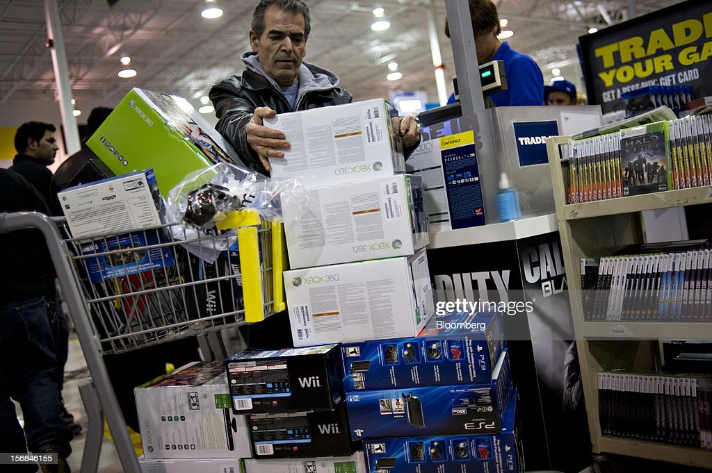 A shopper stacks his purchases on a cart as they are rung up at a Best Buy Co. store in Peoria, Illinois, U.S., on Friday, Nov. 23, 2012. Discount store shoppers are prepared to wait in long lines on Black Friday, though they are skeptical about whether they'll get the best deals of the season. Photographer: Daniel Acker/Bloomberg via Getty Images