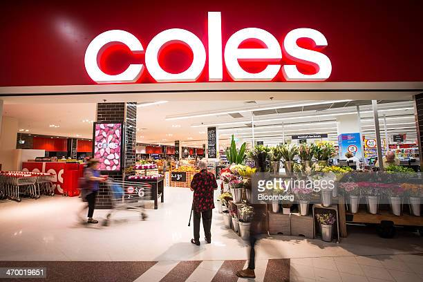 A shopper stands at the entrance to a Coles supermarket operated by Wesfarmers Ltd in Sydney Australia on Tuesday Feb 18 2014 Wesfarmers Australia's...