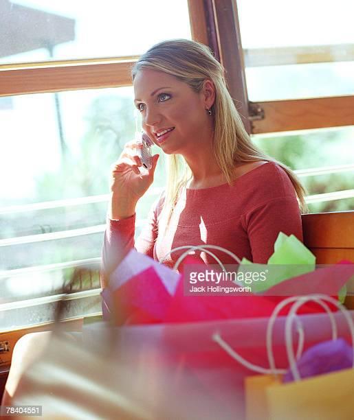 Shopper talking on cellular phone