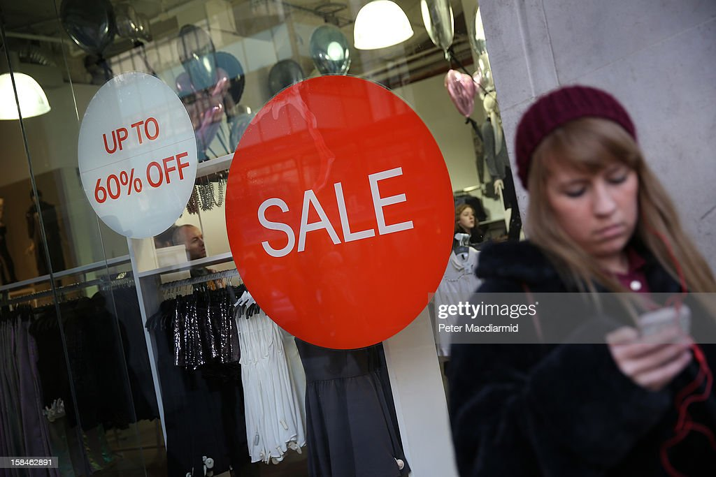 A shopper uses a mobile phone in Oxford Circus on December 17, 2012 in London, England. Thousands of shoppers are expected in London's west end in the hunt for Christmas bargains in the next week.