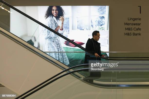 A shopper uses an escalator inside a branch of Marks Spencer Group Plc in London UK on Tuesday Dec 5 2017 Brexit uncertainty and an increase in...