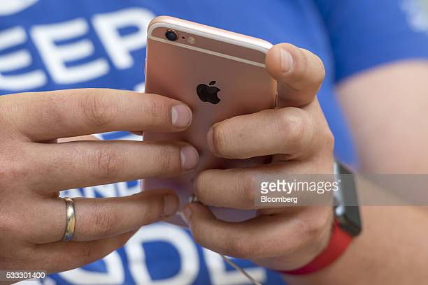 A shopper views an Apple Inc iPhone 5SE during the grand opening of the company's new flagship store at Union Square in San Francisco California US...