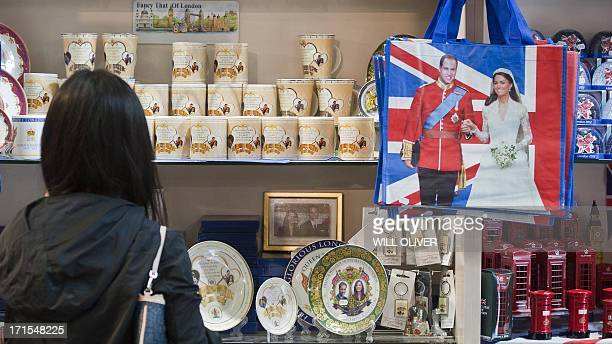 A shopper views souvenir gifts celebrating the upcoming birth of the royal baby of Prince William Duke of Cambridge and Catherine the Duchess of the...
