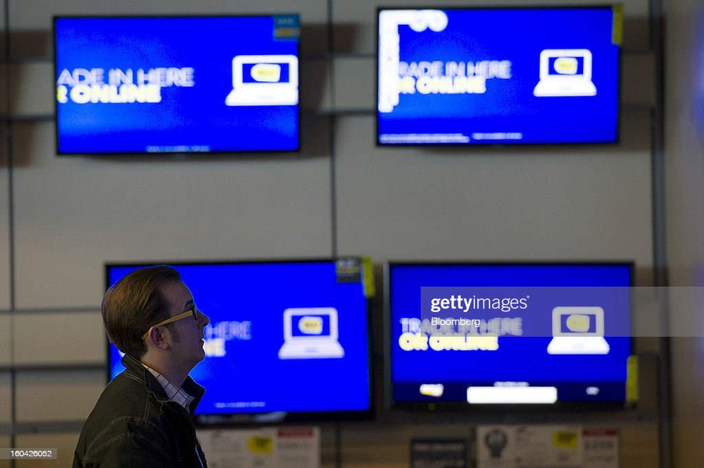 A shopper views televisions at a Best Buy Co. store in San Francisco, California, U.S. on Wednesday, Jan. 30, 2013. Consumer spending in the U.S. climbed in December as incomes grew by the most in eight years, a sign the biggest part of the economy was contributing to the expansion as the year drew to a close. Photographer: David Paul Morris/Bloomberg via Getty Images
