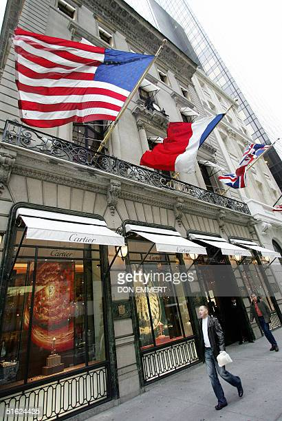 Shopper walk past Cartier on Fifth Ave in Manhattan 29 October 2004 New York's Fifth Avenue and the ChampsElysees in Paris are the most expensive...