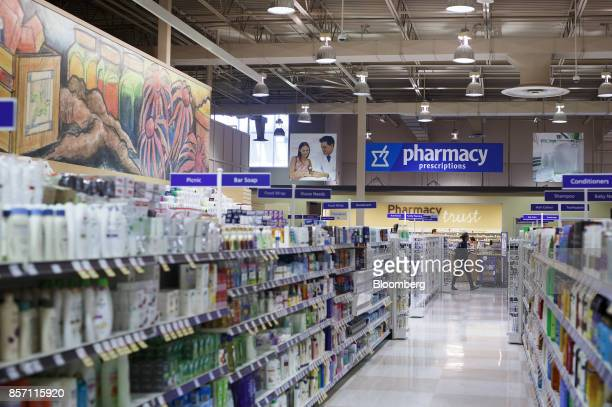 A shopper walk past the pharmacy inside a Metro Inc grocery store in Toronto Ontario Canada on Monday Oct 2 2017 Canadian grocer Metro Inc agreed to...