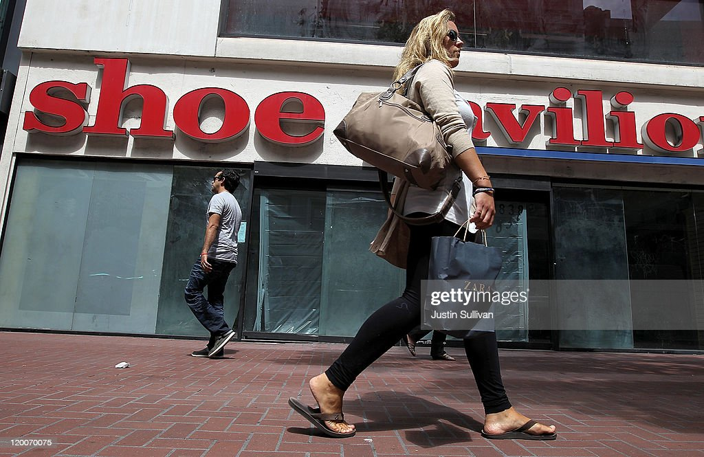 A shopper walks by an out of business shoe store on July 29, 2011 in San Francisco, California. The U.S. Commerce Department reported today that the U.S. economy slowed in the second quarter with the GDP coming in at 1.3 percent, far lower than expected.
