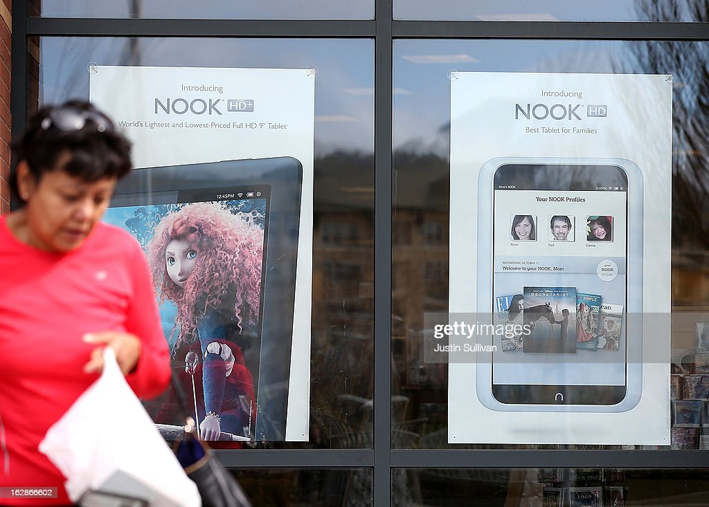 A shopper walks by posters for the Barnes and Noble Nook e-reader at a Barnes and Noble bookstore on February 28, 2013 in San Bruno, California. Bookseller Barnes & Noble reported a weak quarter and a 26 percent drop in sales of its Nook e-reader to post a 8.8 percent decline in revenue and a net loss of $6.1 million, or 18 cents a share, compared to a profit of $52 million, or 71 cents a share one year ago.