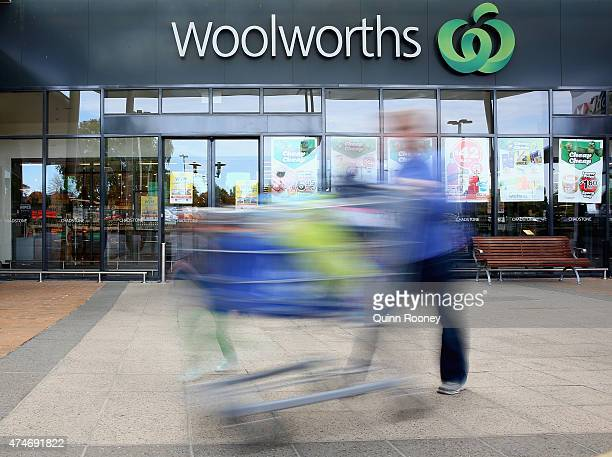 A shopper walks out of Woolworths supermarket on May 25 2015 in Melbourne Australia In a bid to regain its title as Australia's distinguished...