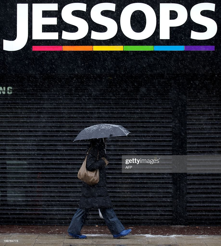A shopper walks past a branch of trobled photographic retail chain Jessops on Oxford Street in central London on January 20, 2013. Four big British high-street retailers had to call in administrators this winter as cash-strapped, web-literate consumers proved unforgiving of stores failing to adapt to fast-evolving markets. AFP PHOTO/ANDREW COWIE