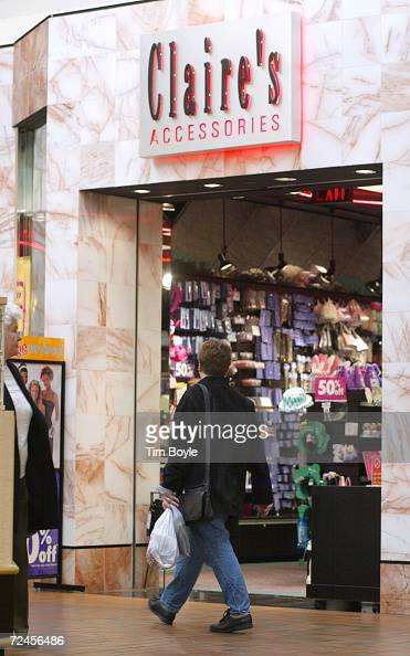 A shopper walks past a Claires Accessories store March 13 2002 at Golf Mill Shopping Mall in Niles IL The US Commerce Department reported March 13...