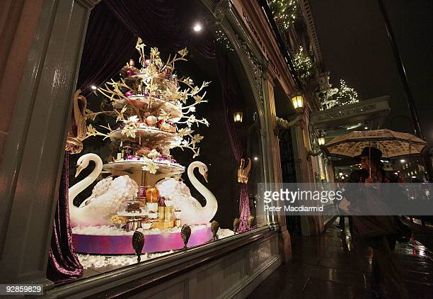 A shopper walks past a newly unveiled Christmas window of Fortnum Mason grocery store on November 6 2009 in Picadilly London Shops are preparing for...