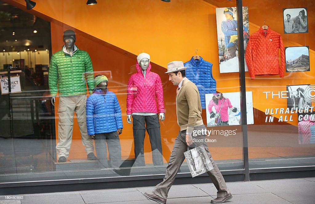 A shopper walks past a window display at a North Face store along the Magnificent Mile shopping district on September 13, 2013 in Chicago, Illinois. According to the Commerce Department retail sales rose a seasonally adjusted 0.2 percent in August from the previous month, short of the 0.5 percent anticipated by economists.