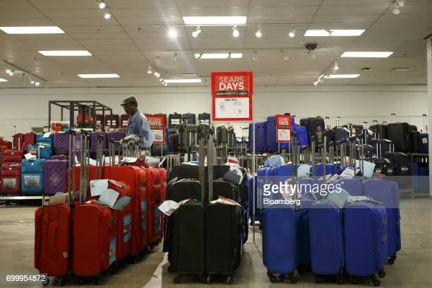 A shopper walks past luggage displayed for sale at a Sears Canada Inc store inside a mall in Toronto Ontario Canada on Thursday June 22 2017 Canadian...