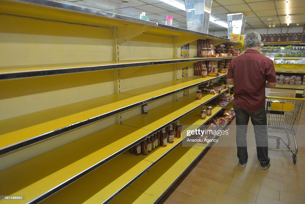 spiral aisle shortage in venezuela due to economical crisis photos and images