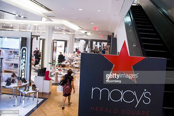A shopper walks though a Macy's Inc department store in New York US on Monday August 10 2015 Macy's Inc the largest US departmentstore company is...