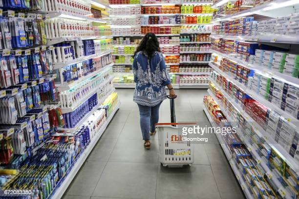 A shopper walks through an aisle displaying personal care goods at a Big Bazaar hypermarket operated by Future Retail Ltd in Mumbai India on Sunday...